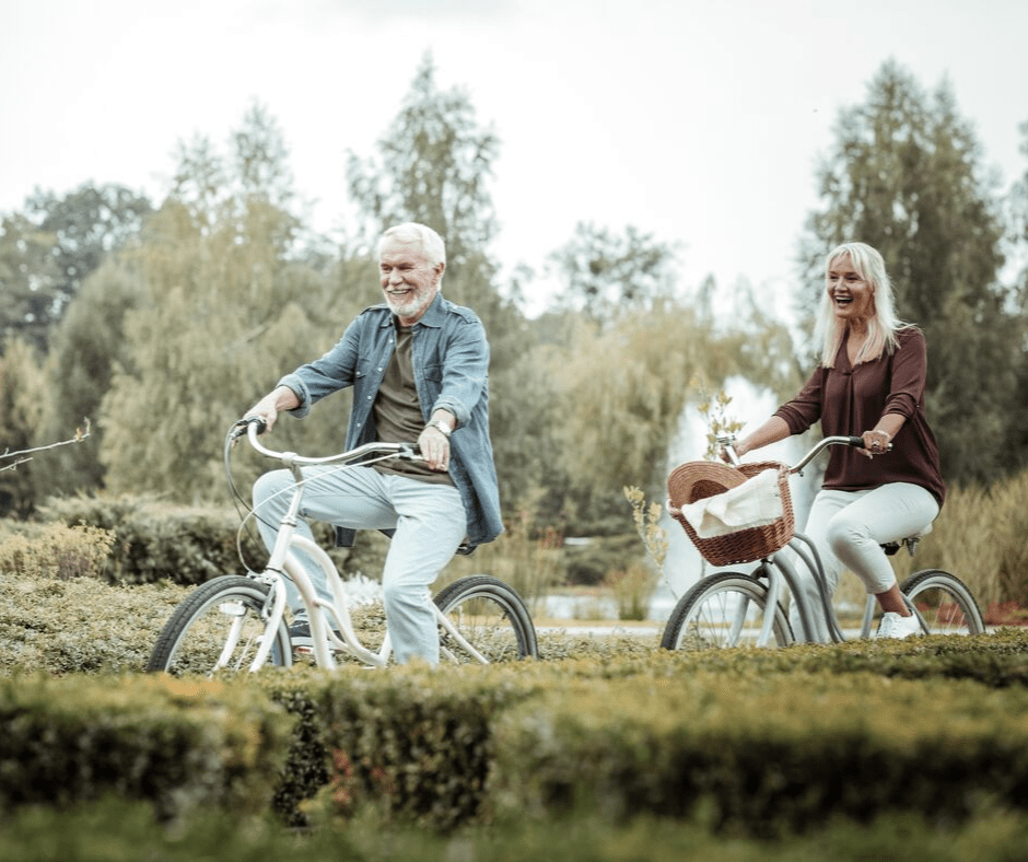 Active Aging Couple Riding Bikes